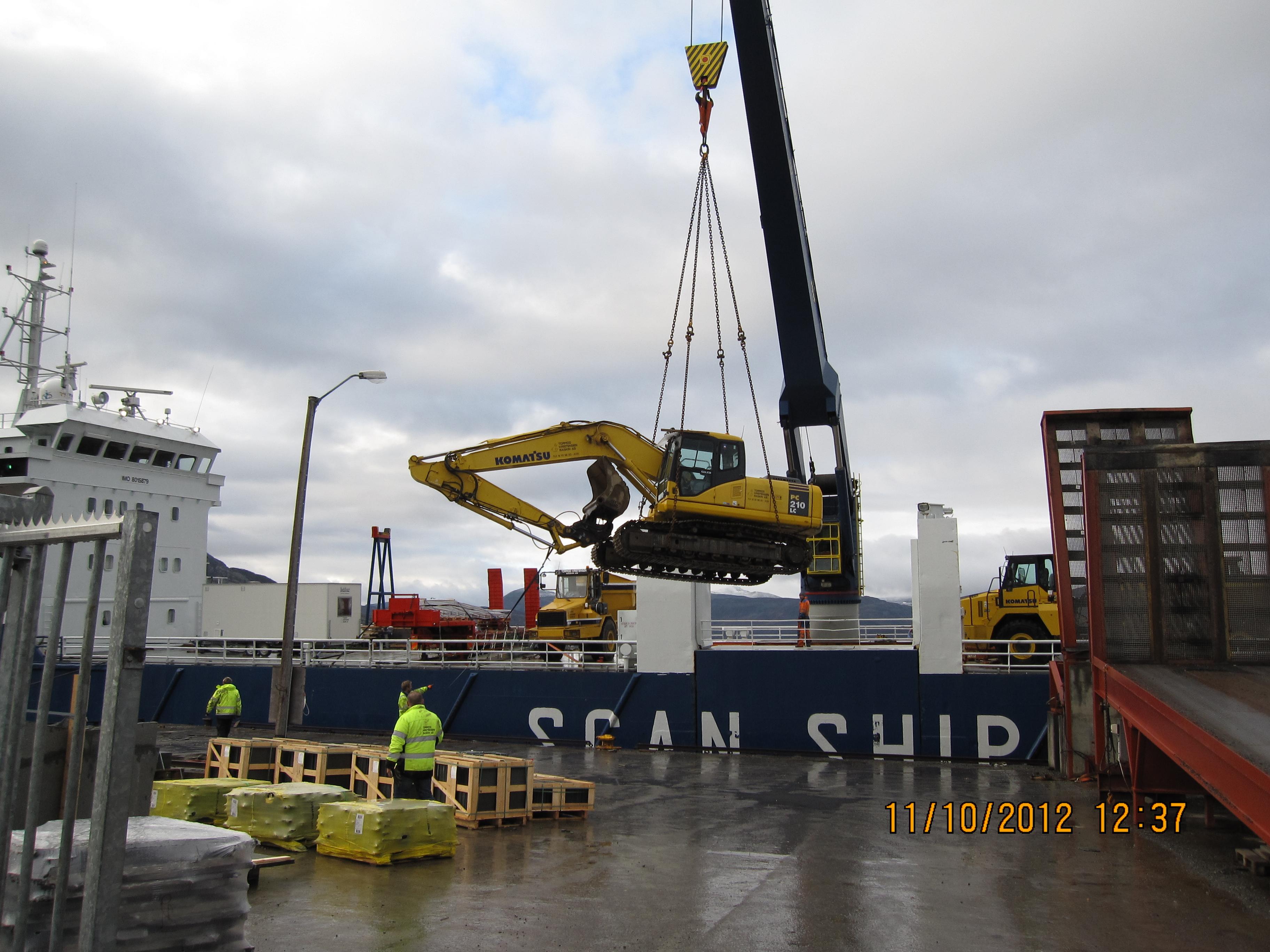 Komatsu 210, veier 23 tonn